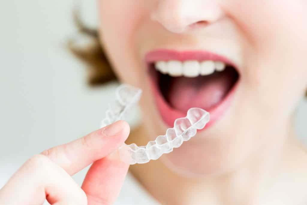 Tips To Effectively Using Invisalign Featured Image - Weber Orthodontics